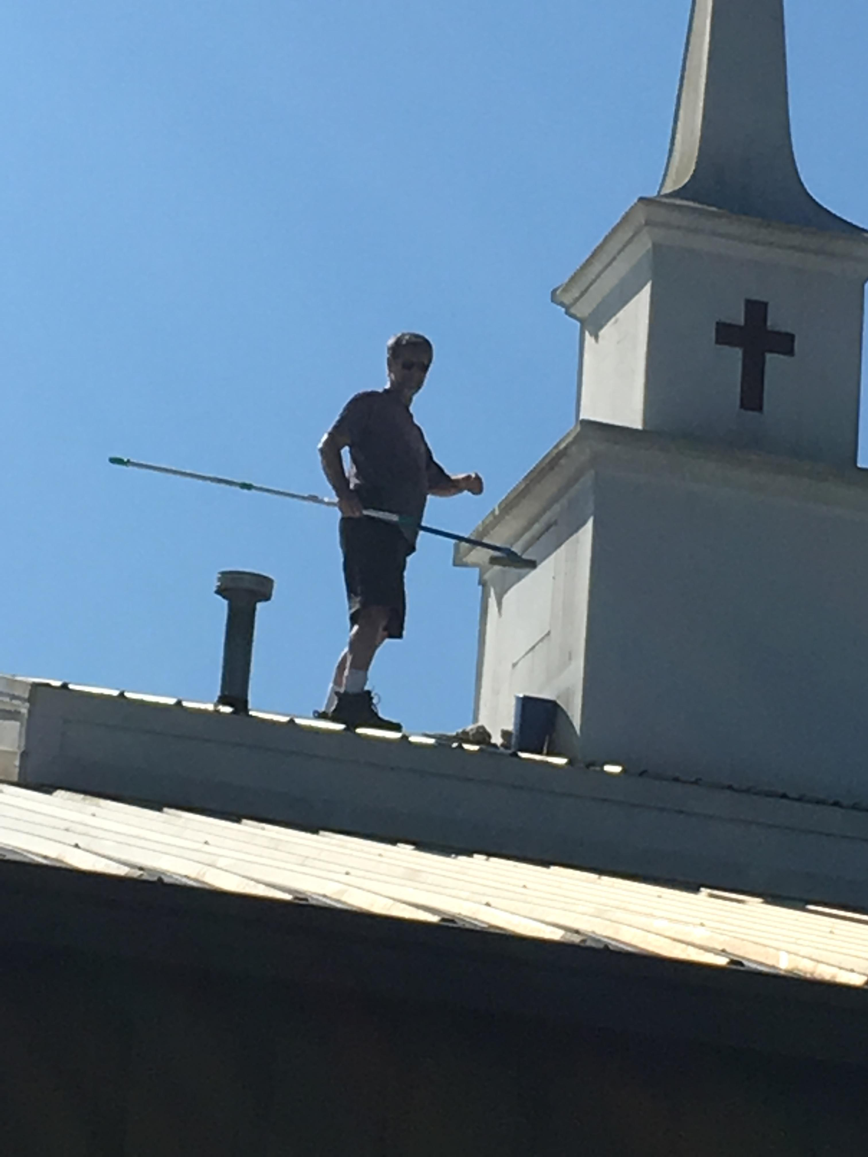 Fr. Bill Cleaning The Steeple